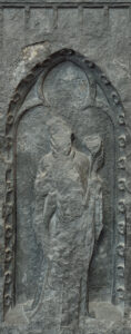 Photo of the weeper of the funerary monument in its current degraded state.